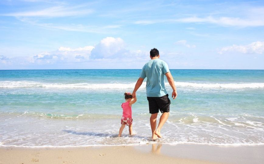 Father And Daughter Playing On A Beach Stay Fit On Vacation