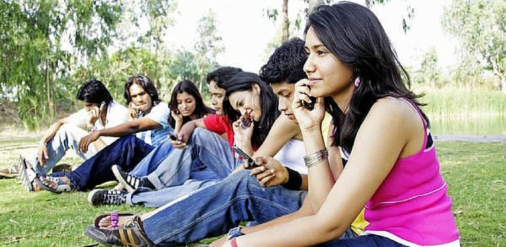 friends talking on phone in group trending us