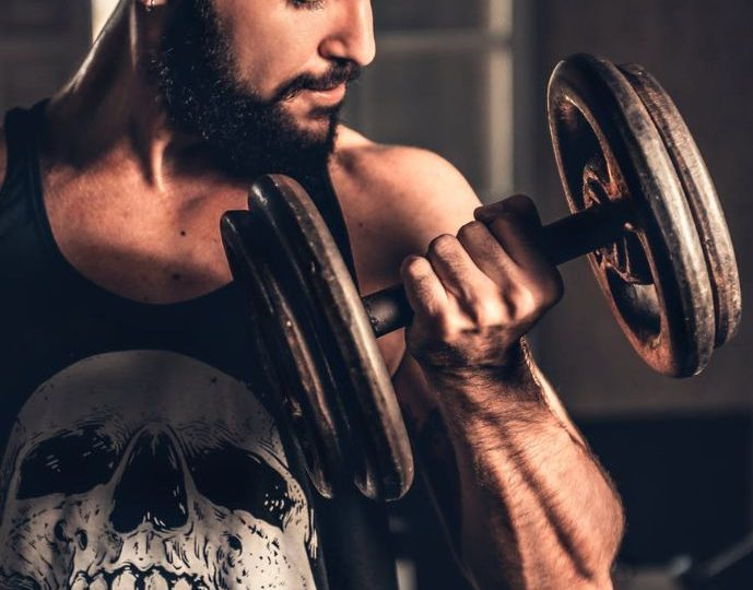 A Man Practising With Dumbles To Gain Biceps - take control of your life
