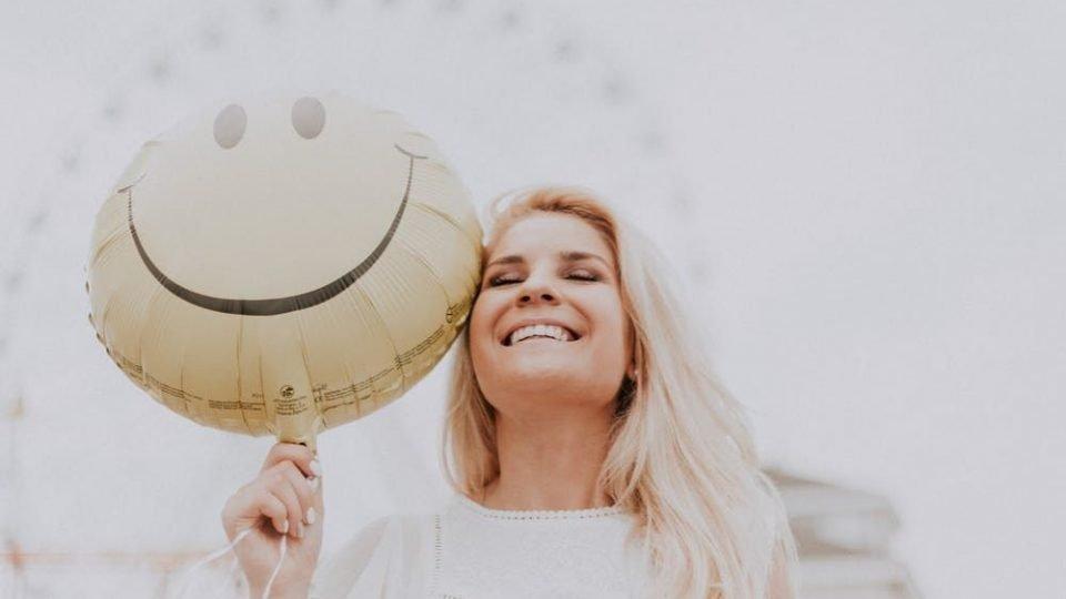 Smiling Woman Overcome Sadness