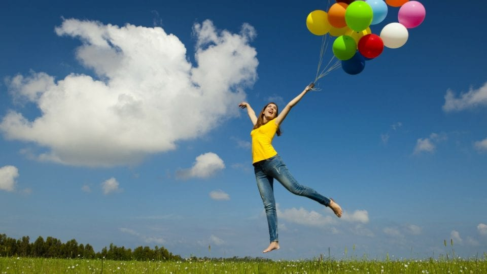 happy people jumping with baloons
