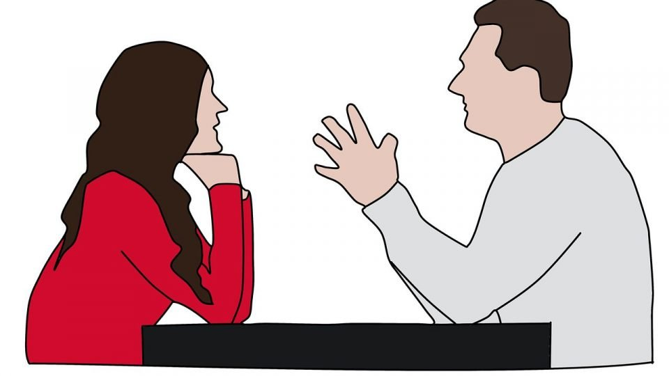 Man And Woman Talking With Each Other