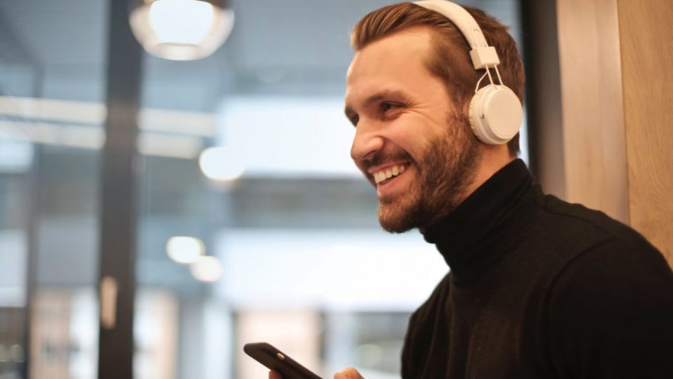 Man Listening To Songs Wearing A Headphone Things To Do Before Going To A Concert