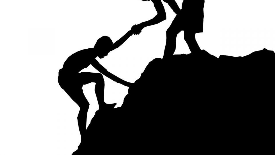 A Boy Helping His Friend To Climb The Mountain - the most important thing in life