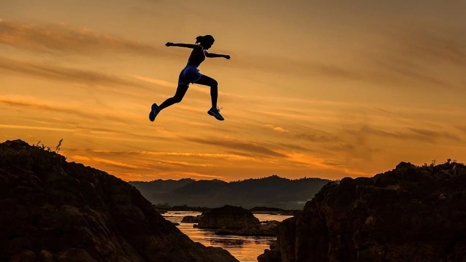 Woman Jumping From A Short Mountain - the most important thing in life